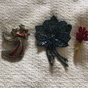 Three brooches for the prize of one.